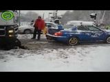A Subaru WRX STi pulls a semi stuck in the snow