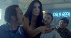 Adriana Lima Brings Football to a Sports Bar - FIFA World Cup