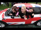 28 women stuff themselves in a Mini to set Guinness world record
